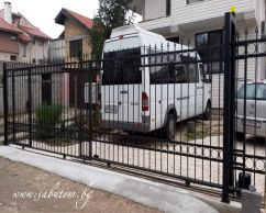 Telescopic sliding gate with operator